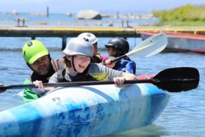 Youth kayakers learn to eskimo roll a kayak in Pucon Chile.